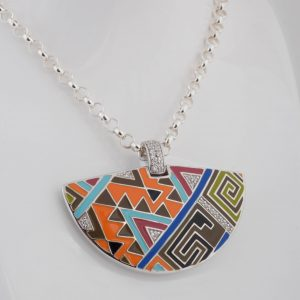 Carefully hand painted Italian enamels, expresses an intricate triangular mosaic of sharp lines