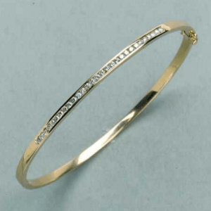 18ct yellow or white gold oval shape hinged bangle with 29=0.58ct round white diamonds