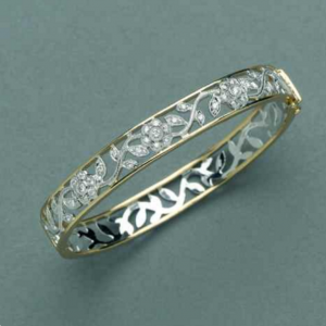 18ct yellow and white gold open filigree with 37=0.75ct round white diamonds.